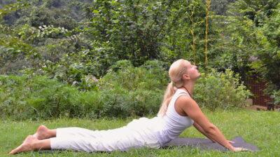 yoga poses - Liisa performing full Bhujangasana, the cobra pose