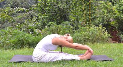 yoga poses - Liisa performing paschimottanasana