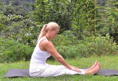 Yoga poses - Liisa demonstrating modified paschimottanasana